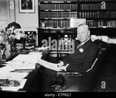 British Home Secretary Sir William Joynson-Hicks sitting at his desk in his office 14th July 1928. - Stock Photo