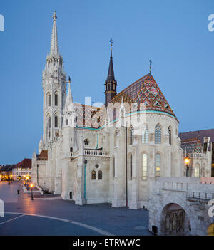 Matthias Church, a Roman Catholic church,  seen from  Fisherman's Bastion before sunset  on the Castle hill in Budapest, - Stock Photo