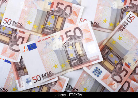 Motley background from chaotically scattered euros banknotes. - Stock Photo