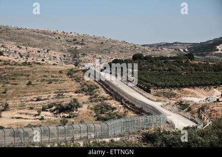 Majdal Shams, Israel. 15th June 2015.The Israeli-Syrian border fence runs adjacent to the Druze village of Majdal - Stock Photo