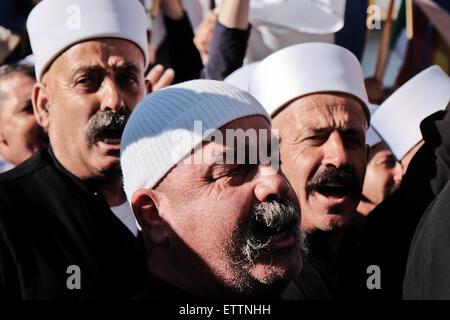 Majdal Shams, Israel. 15th June 2015. Druze residents of Majdal Shams in the Golan Heights march in the village's - Stock Photo