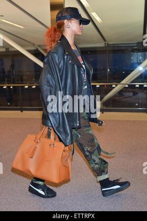 fa7de7fcc Rihanna arrives at Narita International Airport wearing a Palace ...