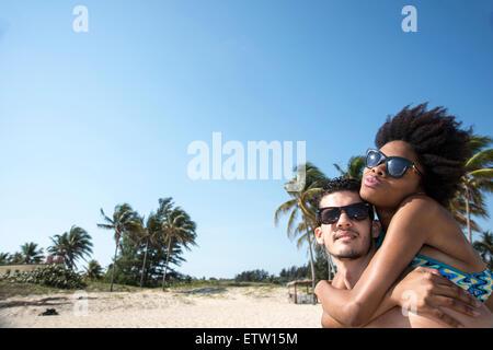 A Latin couple on the beach - Stock Photo