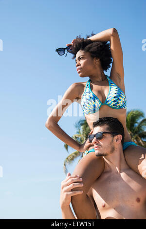 A Latin couple on the beach - Stock Photo