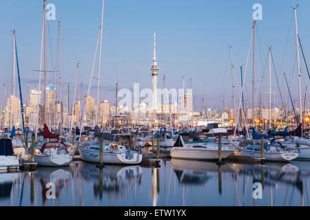 New Zealand, Auckland, Westhaven Marina, Skyline with Sky Tower, blue hour - Stock Photo