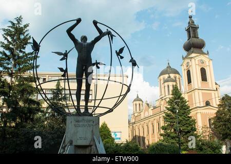 Sculpture by Francesco Perilli, 'The multicultural man will build the world' in Liberation Square  Sarajevo, - Stock Photo