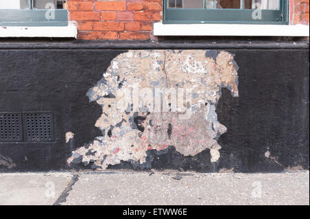 need of repair in foundations leading to settlement structural movement failing damp proof course wet water damage - Stock Photo