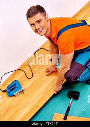 Men laying parquet at home - Stock Photo
