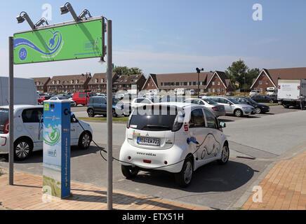 List, Germany, E-car at a Elektrotankstelle - Stock Photo