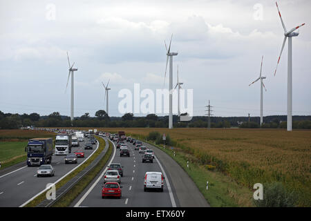 Neuruppin, Germany, slow traffic on the A24, windmills on the field - Stock Photo