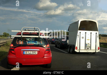 Neuruppin, Germany, car with Pferdeanhaenger stands on the A24 in a traffic jam - Stock Photo