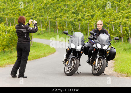 Motorcyclist takes pictures of her companion
