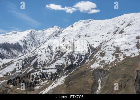 View from Georgian Military Highway, Georgia near Gudauri ski resort in Greater Caucasus Mountains - Stock Photo