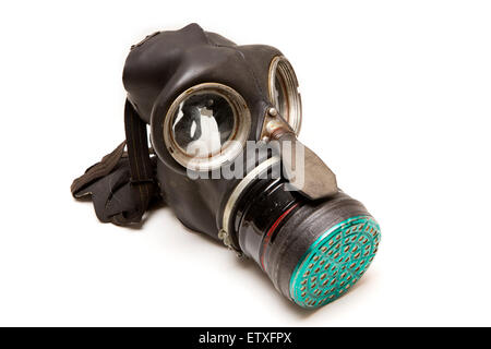 health hazards, WW2 adult civilian gas mask, with filter containing hazardous chrysotile asbestos - Stock Photo