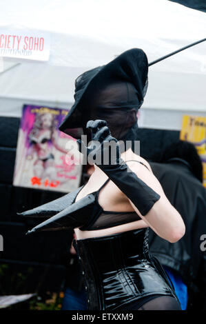 Brick Lane London 2015. Vauxhall Art Car Boot  fair. Art Society Soho .Dominitrix - Stock Photo