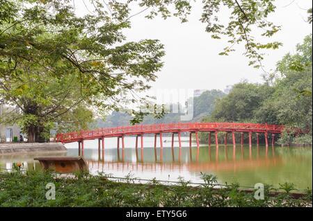Red Bridge in lake of the Restored Sword, Hoan Kiem Lake, Ha Noi, Vietnam - Stock Photo