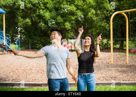 Couple Playing with Bubbles - Stock Photo