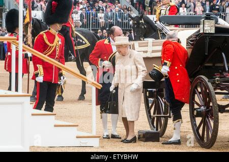 Queen Elizabeth II arrives by carriage for the annual Trooping the Colour parade marking her official birthday on - Stock Photo
