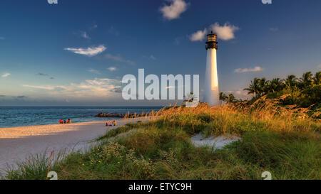Lighthouse on the beach at sunset, Cape Florida Lighthouse, Bill Baggs Cape Florida State Park, Florida, USA - Stock Photo