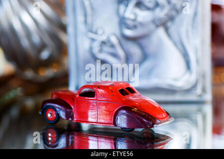 Colorful dinky model car from 1930's in exotic setting. - Stock Photo