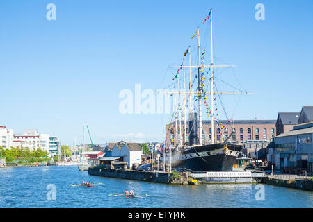 Rowers passing Brunel's SS Great Britain Bristol Docks Bristol Avon England UK GB EU Europe - Stock Photo