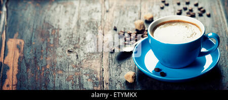 Blue coffee cup on vintage wooden background - Stock Photo