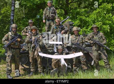 German army soldiers with the Recon Platoon, Jager Battalion 292 pose with an unmanned aerial vehicle UAV Aladin - Stock Photo