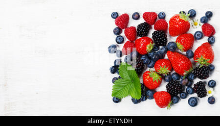 Fresh berries on old wooden background - Stock Photo