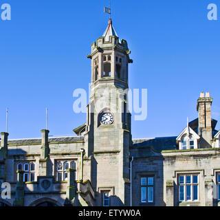 Detail of exterior frontage and Clock Tower of Carlisle city railway station (Citadel station), built 1847 in neo - Stock Photo