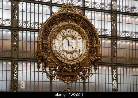 Gilded baroque clock in the main hall of the Musee d'Orsay, Paris, France - Stock Photo