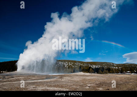 Old Faithful Geyser erupting in Yellowstone National Park, WY - Stock Photo
