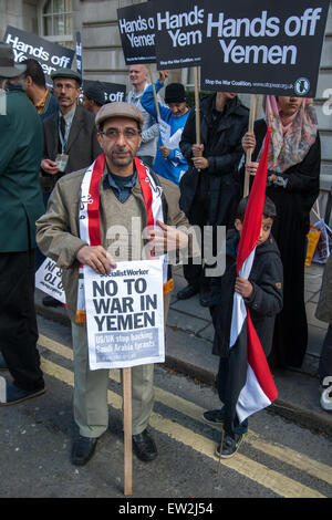 Protesters hold anti-war placards and flags opposite the Royal Embassy of Saudi Arabia in London.  Featuring: View - Stock Photo