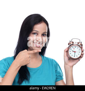 Happy young woman showing old style antique alarm clock against white - Stock Photo