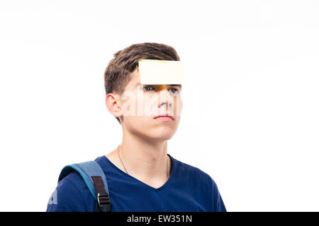 Closeup portrait of a man with sticker on forehead isolated on a white background. Looking away - Stock Photo