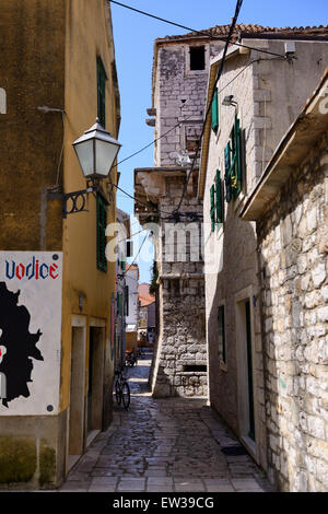 Narrow cobbled street in old town of Vodice on Dalmatian Coast of Croatia - Stock Photo