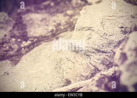Vintage toned nature abstract background made of rocks, shallow depth of field. - Stock Photo