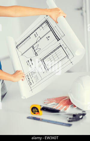 blueprint, flexible ruller, helmet and hammer - Stock Photo