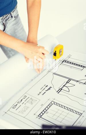 architect drawing on blueprint - Stock Photo