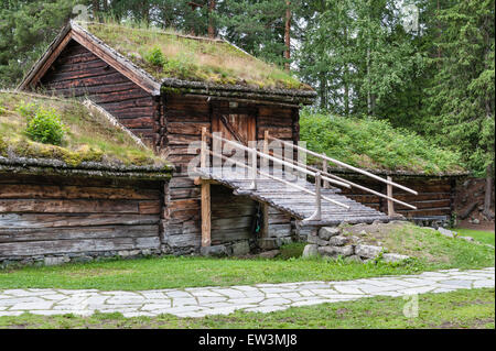 Lillehammer, Norway. The Maihaugen open-air museum of traditional buildings and Norwegian culture. Wooden farm buildings - Stock Photo