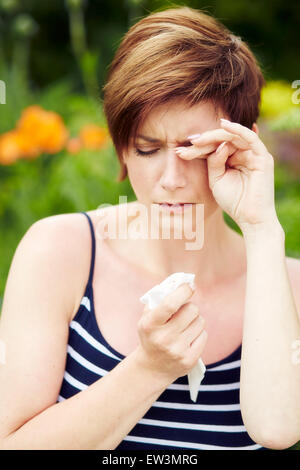 Girl with hayfever - Stock Photo
