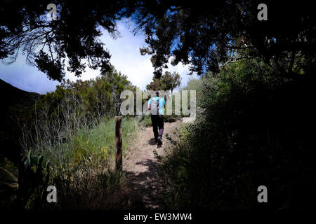 A hiker at Parque Rural de Teno at the northern part of the Canary Island of Tenerife, Spain - Stock Photo