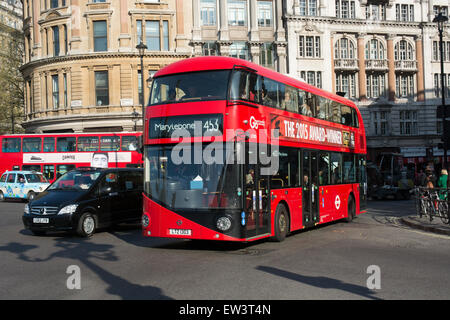A new bus for London Routemaster passes through Charing Cross on route 453 to Marylebone - Stock Photo