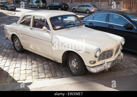 Helsinki, Finland - June 13, 2015: Old white Volvo Amazon 121 B12 car is parked on the roadside in Helsinki - Stock Photo