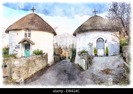 Beautiful thatched round houses at Veryan on the Roseland peninsular in Cornwall - Stock Photo