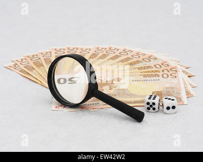 Investing in the Euro concept. Real Euro notes under real magnifying glass with real magnification. - Stock Photo