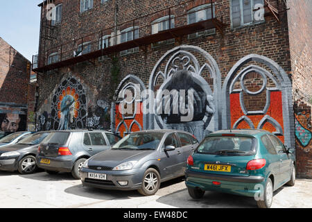Graffiti Artwork on the side of an old industrial building in Sheffield England - Stock Photo