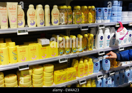 MALMEDY, BELGIUM - MAY 2015: Aisle with a variety of baby care products in a Carrefour Hypermarket. - Stock Photo