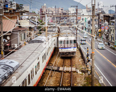 Passing trains on the railway line in Onomichi City, Japan. - Stock Photo