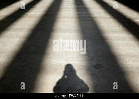 Self-portrait in shadows - Stock Photo