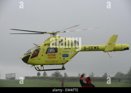 Yorkshire Air Ambulance taking off in rainy weather, Barnsley, South Yorkshire, UK. Picture: Scott Bairstow/Alamy - Stock Photo